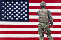 American military over an American flag background Stock Photography