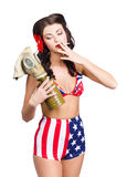 American military pin up girl holding gasmask. American military pin up girl taking a breather from the hostilities to light a cigarette outside her gasmask Royalty Free Stock Photography