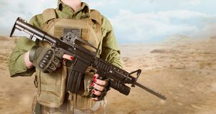American military soldier woman`s hands holding a rifle
