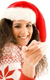 American Model In Christmas Hat Pointing Towards Royalty Free Stock Image