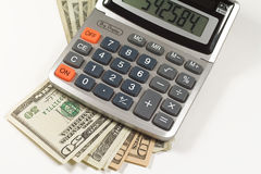 American money and calculator Royalty Free Stock Photos