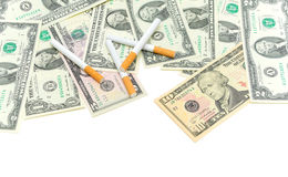American money and cigarettes Royalty Free Stock Images