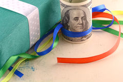 American money dollars and green gift box Royalty Free Stock Photo