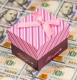 American money and gift box Royalty Free Stock Photography