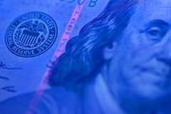 American Dollars in UV rays. American money - hundred dollars in UV rays royalty free stock photos