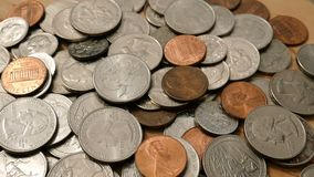 American money. Large pile of coins of American cents of different denominations. Coins are falling from above. Financial background. Selective focus. Close-up stock video footage