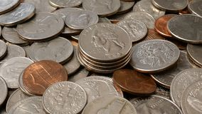 American money. Large pile of coins of American cents of different denominations. Financial background. Selective focus. Close-up stock footage