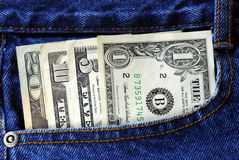 American money is in the pocket of blue jeans. United States money is in the pocket of blue jeans Stock Image