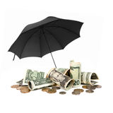 American Money sheltered by Black Umbrella over White Background Royalty Free Stock Photography