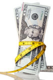 American money with a tape measure Royalty Free Stock Photos