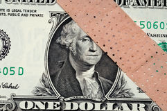 American Money With A Bandage Royalty Free Stock Image