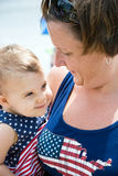 American mother holding her cute baby Stock Image