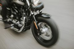 American motorcycle close up detail with blurry motion effect. Fast black motorcycle going fast on the road. Close up detail royalty free stock photography