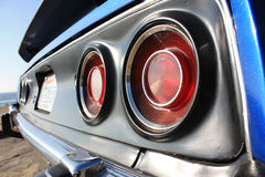American Muscle  |  Barracuda. 1973 E Barracuda in Hemi Blue. Detail on the original taillights of this original American muscle car Royalty Free Stock Images