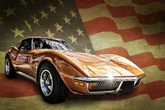 American Muscle Car. Photo of a classic American muscle car isolated and placed on a grunge style American flag background Stock Photography