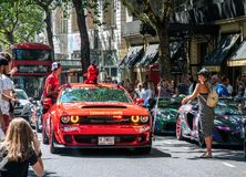 Red Dodge Challenger SRT Demon. 5 August 2018 - London, England. Powerful red American Muscle, Dodge Challenger SRT Demon with Dubai license plates at Gumball stock photo