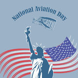 American_NAD. Abstract vector illustration National Aviation Day depicts the Statue of Liberty with the Wright brother's airplane flying over it and the Stock Images