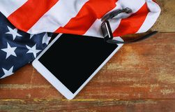 American national flag and e-tablet on wooden boards. American national flag and e-tablet on old wooden boards us usa united states computer pc technology royalty free stock images