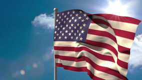 American national flag waving on flagpole. On blue sky background with sun and clouds stock video