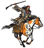 American native indian warrior holding a rifle. American native Indian man holding a rifle and riding a pinto colored pony horse in the gallop . Nomadic horseman Royalty Free Stock Photos