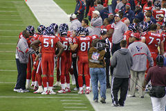 American NFL Football Players with Coaches. The NFL teams, the Houston Texans and the Jacksonville Jaguars played at Houston for Monday Night Football. Several Royalty Free Stock Photography