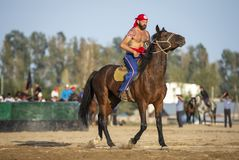 American nomad men getting ready for wrestling on horseback Royalty Free Stock Images