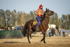 American nomad men getting ready for wrestling on horseback Royalty Free Stock Photo