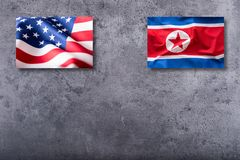 American and North korea flags. Usa and North korea flag on conc Stock Images