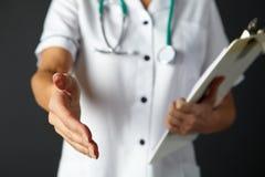 American nurse extending hand  Stock Photography