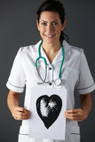 American nurse holding ink drawing of heart stock photography
