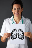 American nurse holding ink drawing of lungs Royalty Free Stock Image