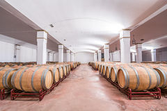 American oak barrels with red wine. Traditional wine cellar Royalty Free Stock Photos