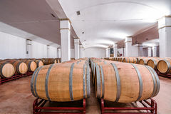 American oak barrels with red wine. Traditional wine cellar Royalty Free Stock Images