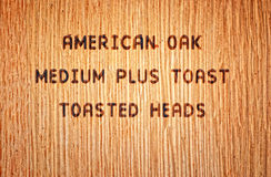 American Oak Wine Barrel. Wood burned stamp on American Oak wine barrel royalty free stock image