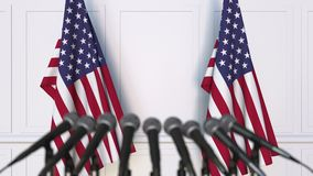 American official press conference. Flags of the United States and microphones. Conceptual animation. Official press conference. Flags and microphones stock video