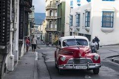 Classic car in street of Santiago de Cuba Royalty Free Stock Photo
