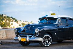 American Oldtimer in Cuba Taxi. American Oldtimer parked in Cuba Havana on the promenade Royalty Free Stock Images