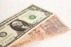 American one dollars and Indian ten rupee banknote. On white background Royalty Free Stock Photos