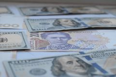 American one hundred dollars banknote and ukrainian hryvnas stock photography