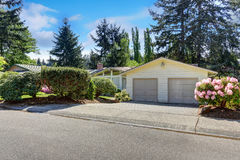 American one level house exterior double garage and driveway. Stock Photo