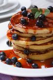 American Pancake with fresh blueberries and maple syrup Stock Image