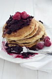 American pancakes with berries. American pancakes with summer berries on top Royalty Free Stock Photo