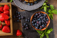 American pancakes with berries and chocolate. American pancakes with chocolate, strawberries and blueberries Stock Image
