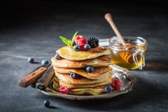 American pancakes with blueberries and raspberries. On dark table Royalty Free Stock Photography