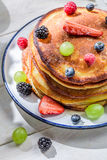 American pancakes with fresh fruits for breakfast Stock Images