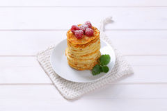 American pancakes with fresh raspberries. Stack of american pancakes with fresh raspberries on white plate Royalty Free Stock Images