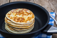 American pancakes in frying pan Royalty Free Stock Images
