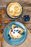 American pancakes with sauce and blueberries on wooden table top Royalty Free Stock Photography