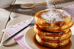 American pancakes with syrup and powdered sugar Royalty Free Stock Photography