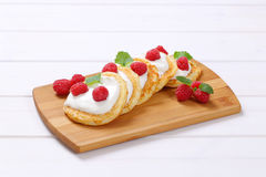 American pancakes with yogurt and raspberries Royalty Free Stock Images